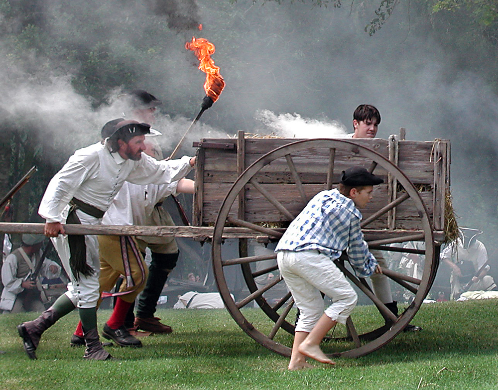 Image of the infamous cart being lit on fire by battle reenactors