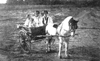 """Playtime, children on the wagon."" Image courtesy of State Archives of North Carolina, call #: N_98_9_188."