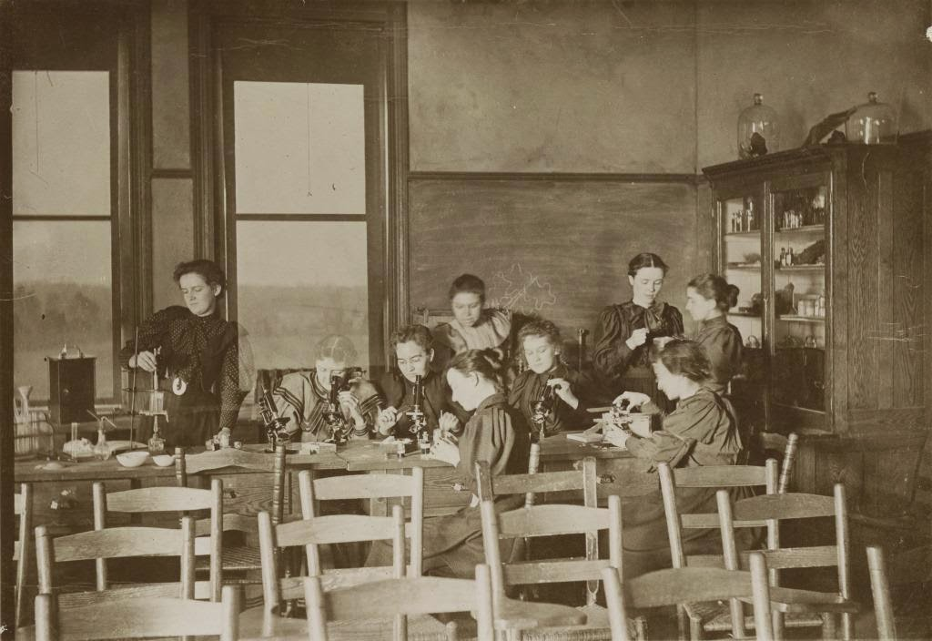 Bryant (standing center) and students in the State Normal School's laboratory, circa 1893. This photograph appears in Bryant's scrapbook and is courtesy of the University of North Carolina Greensboro University Libraries.