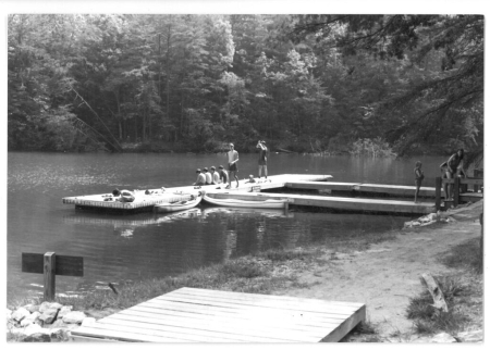Photograph of swimmers at a dock on the Catawba River, Lake James State Park, ca. 1990. North Carolina State Parks Collection.