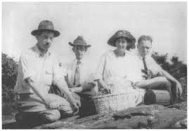 Alma on a botanical collecting trip, circa summer 1921, kneeling on ground with James Coker, Jr, William Coker, and John Couch
