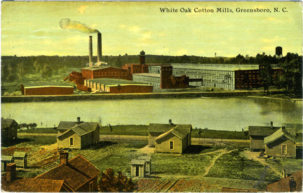 Postcard shows the White Oak Cotton Mills (a division of Greensboro-based Cone Mills) and several houses in the mill village. A river runs between the mill and the village.