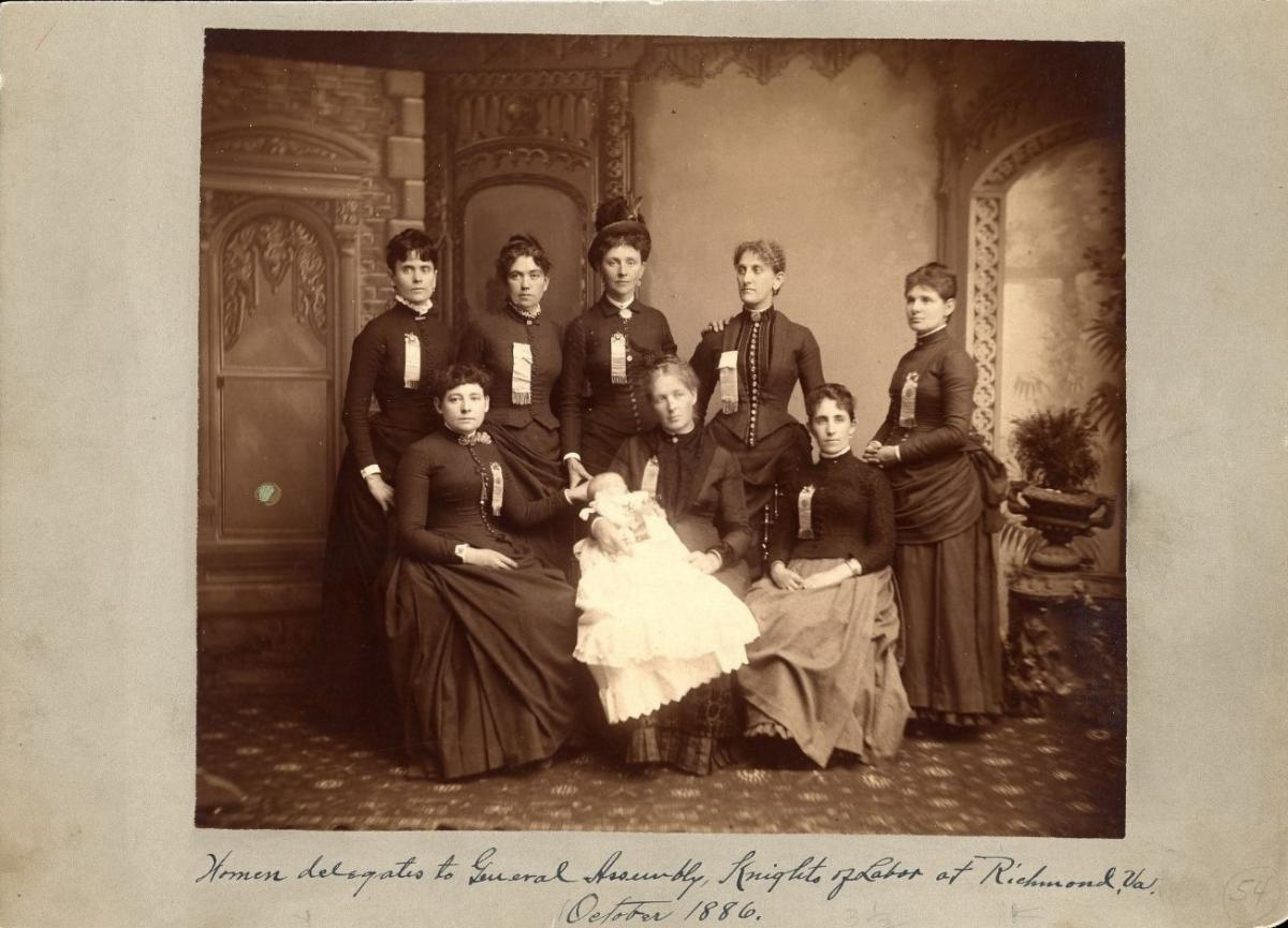 "Photograph of eight women, one of whom is holding a baby, with the caption ""Women delegates to the General Assembly, Knights of Labor at Richmond, Va., October 1886"