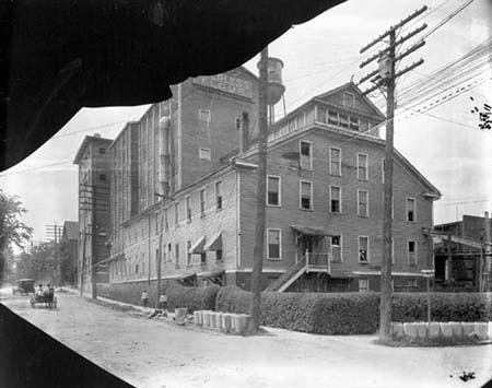Photograph of the Peerless Flour Factory, ca. 1910, Durham, N.C. industrial district. The factory was located at the corner of Vivian and McMannen Streets. From the Parnell Collection, Durham Historic Photographic Archives, Durham County Library. Courtesy of the NC Digital Heritage Center.