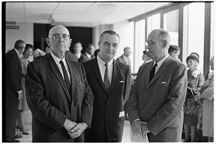 Photograph of dedication of superintendent of Pitt County Schools in 1967. D.H. Conley, former superintendent at the time, stands on the left. Image 741.44.a.32, from the Daily Reflector Image Collection, East Carolina University Digital Collections.