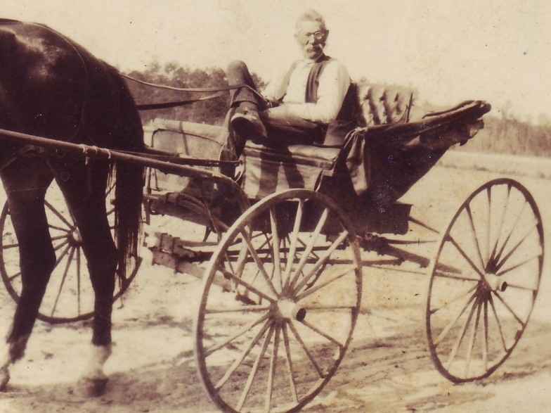 Photograph of Amos Cox in a Hunsucker Buggy, manufactured by the A.G. Cox Manufacturing Company. Used by permission.