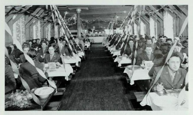 "Photograph of a mess hall at Fort Oglethorpe in Macon, Georgia, in 1944. Gladys Pittman received her basic training at Fort Oglethorpe in 1943. Image from the publication ""The Women's Army Corps, 1945-1978"" by Bettie J. Morden, published by the Center of Military History, 1990."
