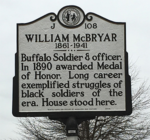 Photograph of the NC Highway Historical Marker for William McBryar, located at East Market and Dudley Streets in Greensboro, NC. Image used courtesy of the Research Branch, NC Office of Archives and History.