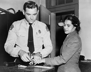 This is a photograph of Rosa Parks being fingerprinted by a white police officer after her arrest for refusing to give up her bus seat, December 1, 1955.
