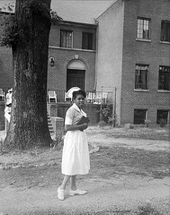 This photograph is of a St. Agnes Hospital Nursing School student in the foreground and a portion of the hospital school in the background. From the Albert Barden Collection, State Archives.