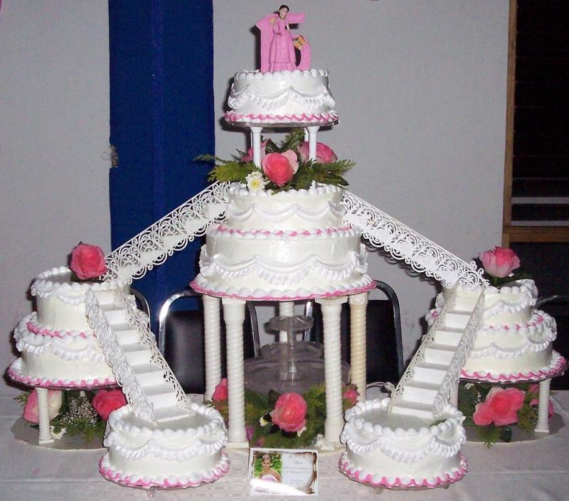 """<img typeof=""""foaf:Image"""" src=""""http://statelibrarync.org/learnnc/sites/default/files/images/12thecake.JPG"""" width=""""1024"""" height=""""902"""" alt=""""Quinceañera cake"""" title=""""Quinceañera cake"""" />"""