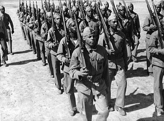 "<img typeof=""foaf:Image"" src=""http://statelibrarync.org/learnnc/sites/default/files/images/8d16408u.jpg"" width=""523"" height=""386"" alt=""African American Marines, World War II"" title=""African American Marines, World War II"" />"