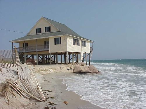 "<img typeof=""foaf:Image"" src=""http://statelibrarync.org/learnnc/sites/default/files/images/beach_house.jpg"" width=""500"" height=""375"" alt=""Beachfront house"" title=""Beachfront house"" />"