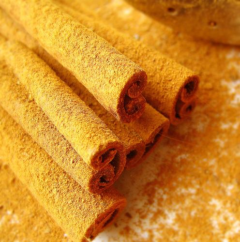 "<img typeof=""foaf:Image"" src=""http://statelibrarync.org/learnnc/sites/default/files/images/cinnamon-sticks.jpg"" width=""496"" height=""500"" alt=""Cinnamon sticks"" title=""Cinnamon sticks"" />"