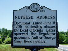 This is an image of the NC Highway Historical Marker for the Nutbush Address, located at NC 39 at Townsville in the County of Vance.