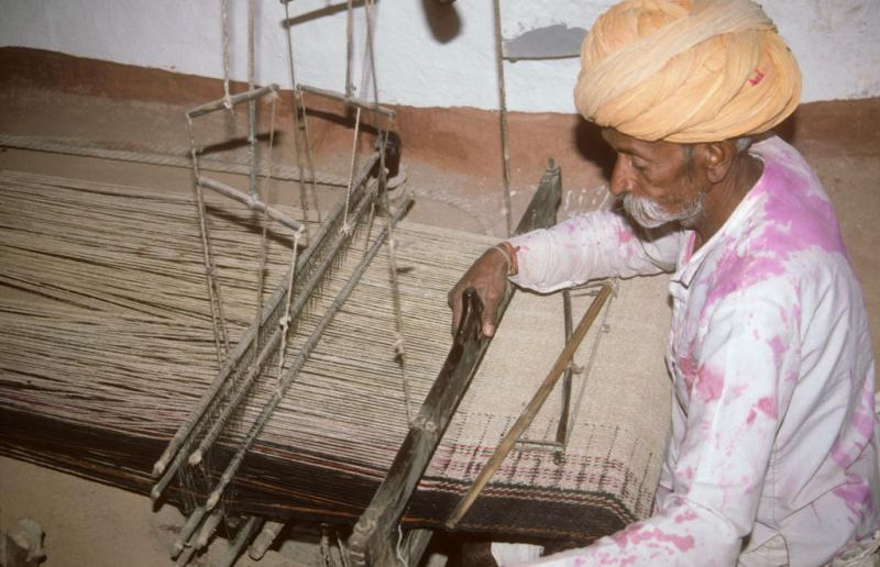 "<img typeof=""foaf:Image"" src=""http://statelibrarync.org/learnnc/sites/default/files/images/india_141.jpg"" width=""1024"" height=""661"" alt=""A weaver near Jodhpur, India"" title=""A weaver near Jodhpur, India"" />"