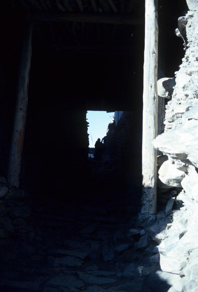 """<img typeof=""""foaf:Image"""" src=""""http://statelibrarync.org/learnnc/sites/default/files/images/nepal_180.jpg"""" width=""""694"""" height=""""1024"""" alt=""""Tunnel into Kagbeni village, Nepal"""" title=""""Tunnel into Kagbeni village, Nepal"""" />"""