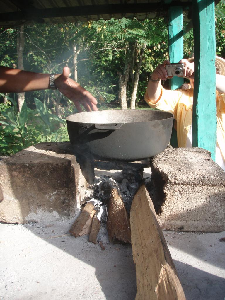 """<img typeof=""""foaf:Image"""" src=""""http://statelibrarync.org/learnnc/sites/default/files/images/p7080622r.jpg"""" width=""""768"""" height=""""1024"""" alt=""""Cacao seeds over the fire"""" title=""""Cacao seeds over the fire"""" />"""