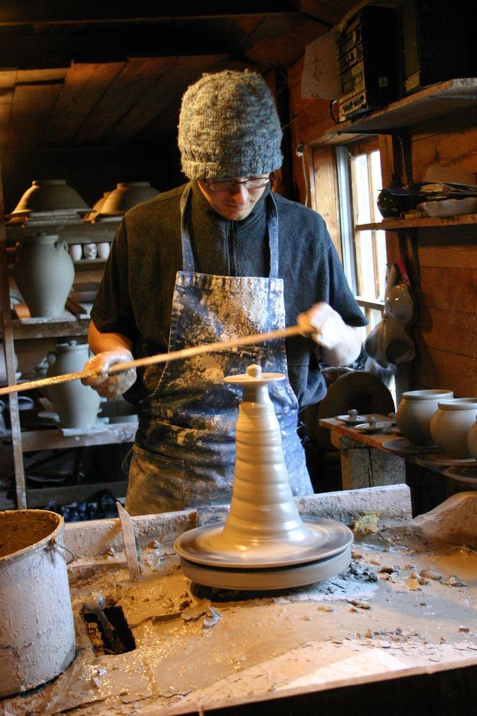 """<img typeof=""""foaf:Image"""" src=""""http://statelibrarync.org/learnnc/sites/default/files/images/randolphcopotter.jpg"""" width=""""683"""" height=""""1024"""" alt=""""A potter working in Seagrove, NC"""" />"""