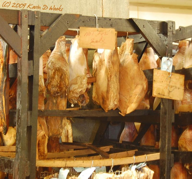 "<img typeof=""foaf:Image"" src=""http://statelibrarync.org/learnnc/sites/default/files/images/smokedhams.jpg"" width=""1167"" height=""1086"" alt=""Smoked hams"" title=""Smoked hams"" />"
