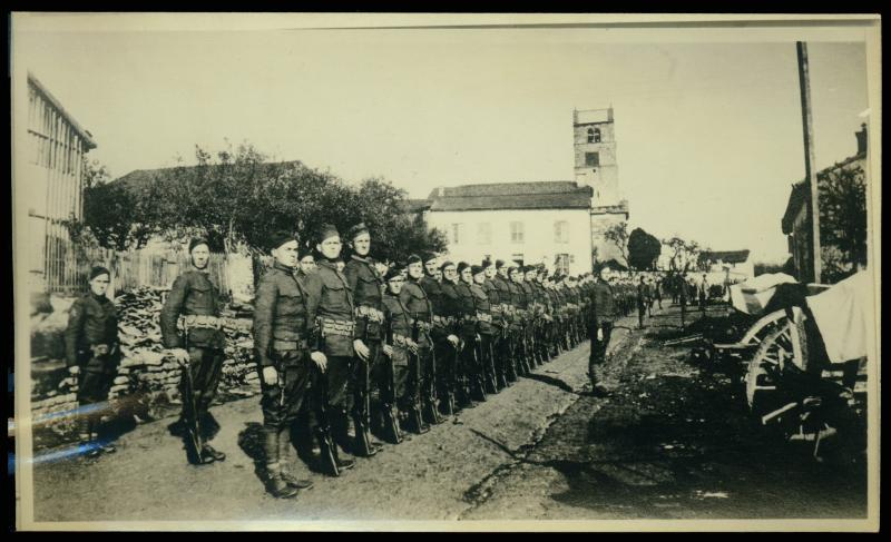 Soldiers stand at attention