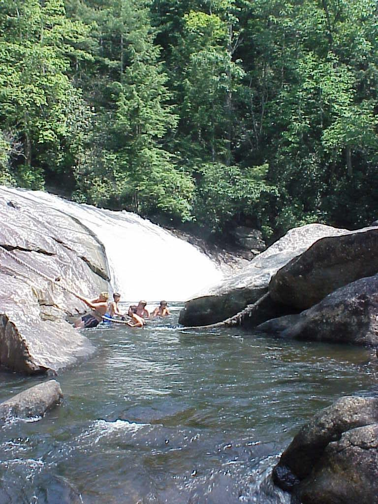 """<img typeof=""""foaf:Image"""" src=""""http://statelibrarync.org/learnnc/sites/default/files/images/turtleback_falls.jpg"""" width=""""768"""" height=""""1024"""" alt=""""Boy Scouts sliding down Turtleback Falls, with forest above"""" title=""""Boy Scouts sliding down Turtleback Falls, with forest above"""" />"""