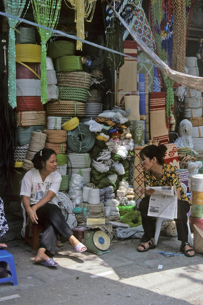 "<img typeof=""foaf:Image"" src=""http://statelibrarync.org/learnnc/sites/default/files/images/vietnam_010.jpg"" width=""683"" height=""1024"" alt=""Two women sit talking outside a rope and mat shop in Hanoi"" title=""Two women sit talking outside a rope and mat shop in Hanoi"" />"