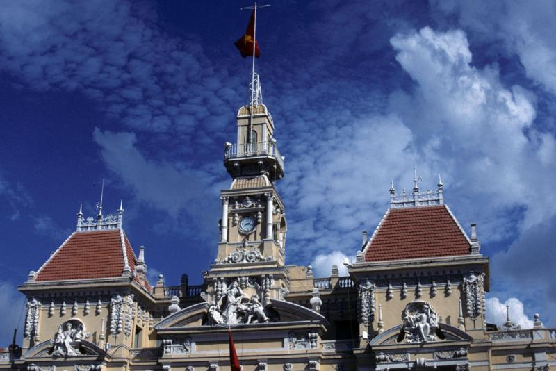 "<img typeof=""foaf:Image"" src=""http://statelibrarync.org/learnnc/sites/default/files/images/vietnam_051.jpg"" width=""1024"" height=""683"" alt=""Close-up view, Ho Chi Minh City's city hall roof line architecture"" title=""Close-up view, Ho Chi Minh City's city hall roof line architecture"" />"