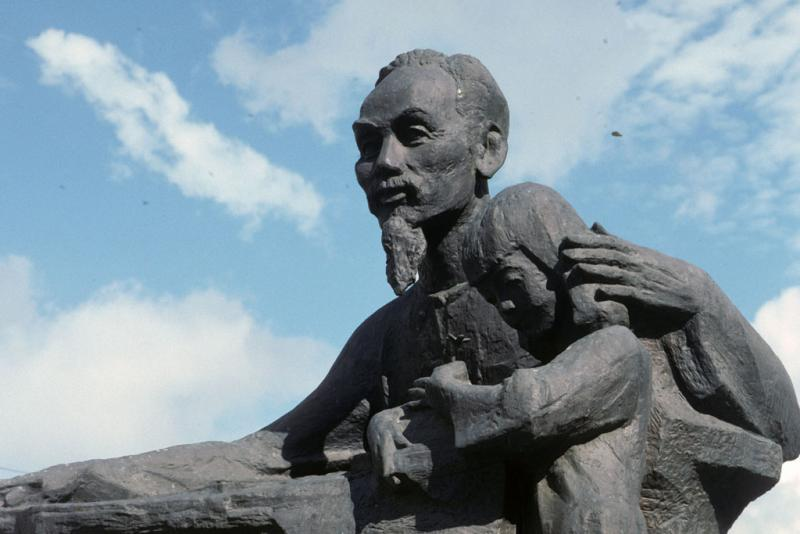 """<img typeof=""""foaf:Image"""" src=""""http://statelibrarync.org/learnnc/sites/default/files/images/vietnam_055.jpg"""" width=""""1024"""" height=""""683"""" alt=""""Stone statue in Hanoi of Ho Chi Minh reading to young girl"""" title=""""Stone statue in Hanoi of Ho Chi Minh reading to young girl"""" />"""