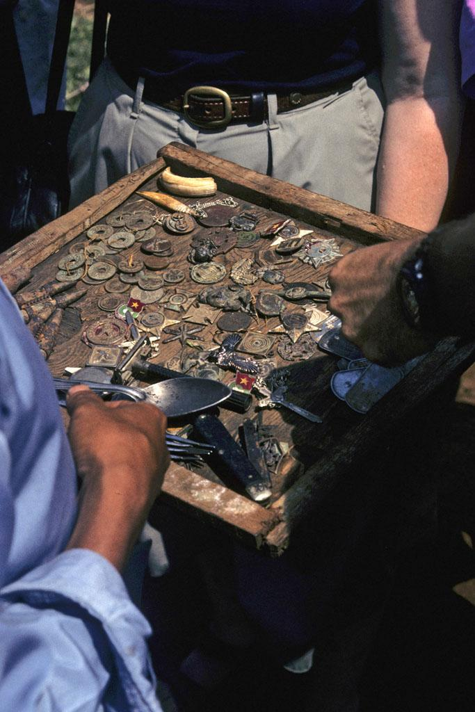 "<img typeof=""foaf:Image"" src=""http://statelibrarync.org/learnnc/sites/default/files/images/vietnam_084.jpg"" width=""683"" height=""1024"" alt=""Tray filled with military badges and other artifacts from the Vietnam wars"" title=""Tray filled with military badges and other artifacts from the Vietnam wars"" />"