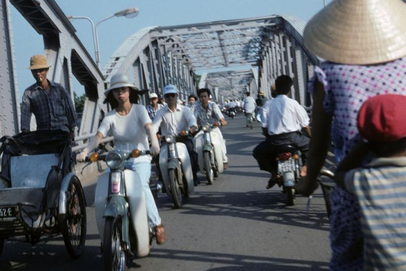 """<img typeof=""""foaf:Image"""" src=""""http://statelibrarync.org/learnnc/sites/default/files/images/vietnam_101.jpg"""" width=""""1024"""" height=""""683"""" alt=""""Motorcycle and bycycle traffic crossing bridge at Hue"""" title=""""Motorcycle and bycycle traffic crossing bridge at Hue"""" />"""