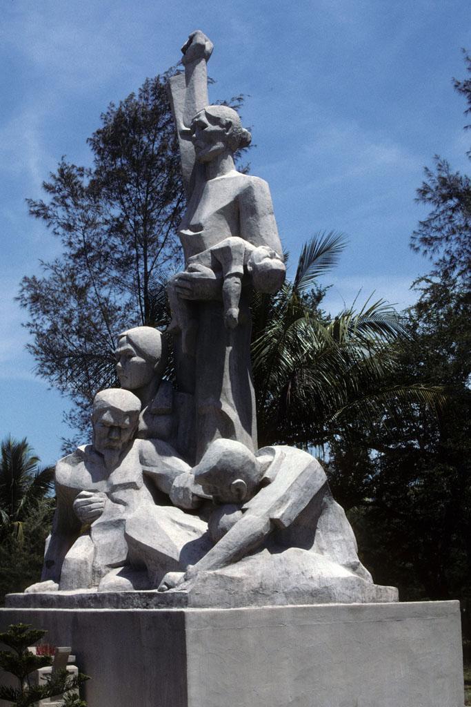 "<img typeof=""foaf:Image"" src=""http://statelibrarync.org/learnnc/sites/default/files/images/vietnam_122.jpg"" width=""683"" height=""1024"" alt=""Stone statue memorial of Communist resistance to Vietnam War, Mai Lai"" title=""Stone statue memorial of Communist resistance to Vietnam War, Mai Lai"" />"