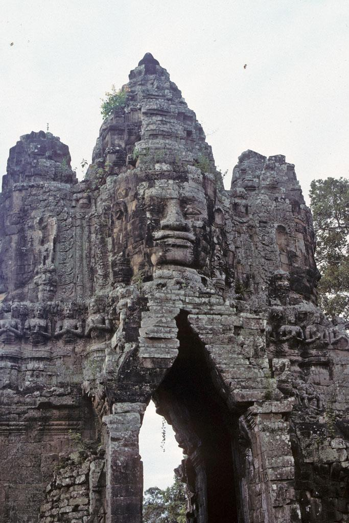 "<img typeof=""foaf:Image"" src=""http://statelibrarync.org/learnnc/sites/default/files/images/vietnam_215.jpg"" width=""683"" height=""1024"" alt=""Face on top of south gate tower of Bayon Temple at Angkor Thom"" title=""Face on top of south gate tower of Bayon Temple at Angkor Thom"" />"