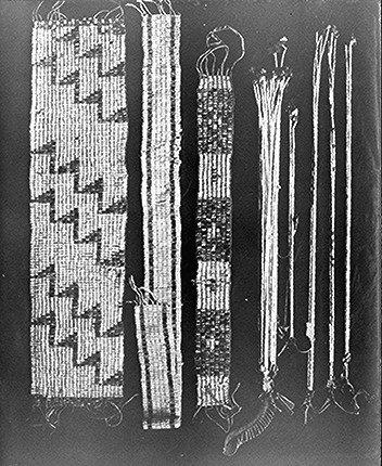 American Indians of eastern North America used wampum belts made from shell beads as money and gifts, and also to encode messages through the weaving of differently colored beads.