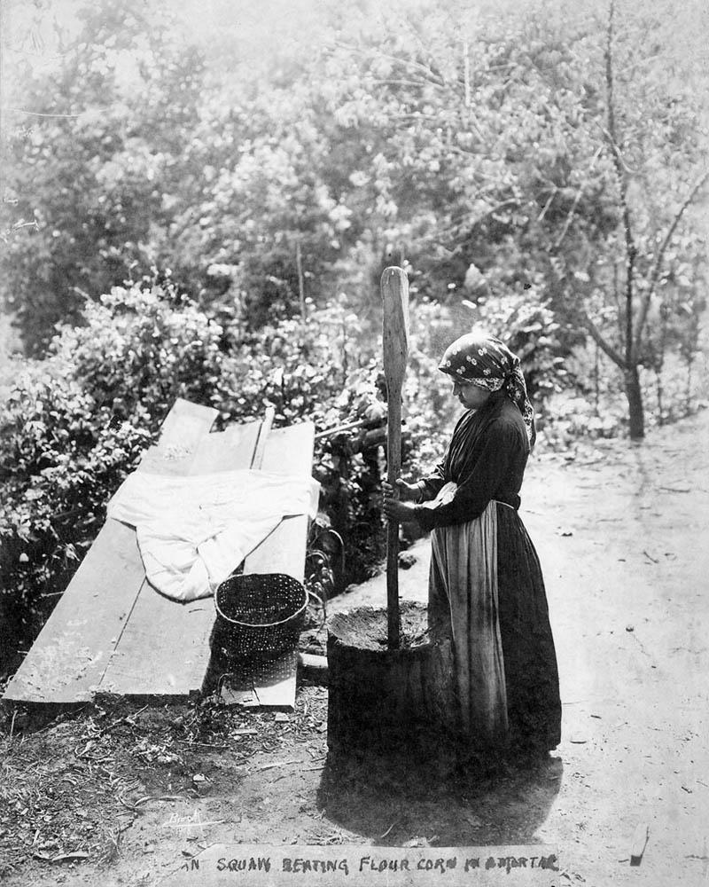 Woman pounding corn