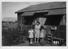 Mrs. Naguchi and two children, Manzanar Relocation Center