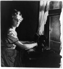 Rural electrification: Girl at sewing machine