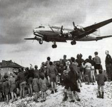 Image of plane and citizens during the Berlin Airlift.