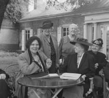 This is a photograph of Alice Paul (far left, sitting) with other members of the National Women's Party in 1950.