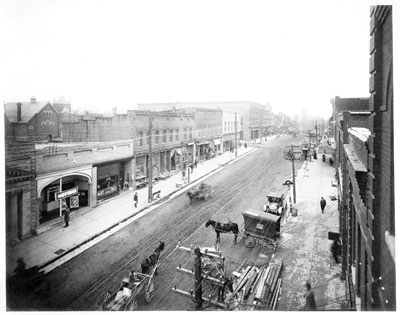 """Wilmington Street business district, looking south, elevated view, Raleigh, NC, c.1915."" From Carolina Power and Light (CP&L) Photograph Collection (Ph.C.68), North Carolina State Archives; call #: PhC68_1_126."