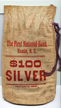 Money bag from the First National Bank in Hamlet. Image from the Museum of History