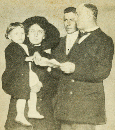 Robert Royal Smithwick of Wendell, N.C. winner of the first Better Baby Contest at the North Carolina State Fair in 1913, receiving a medal from North Carolina Secretary of State J. Bryan Grimes. Image from Archive.org.