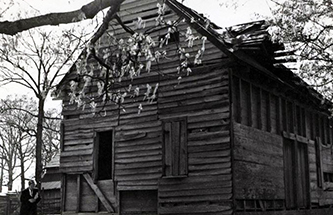 The Charles B. Aycock Birthplace barn before restoration, 1954. Image from the North Carolina Museum of History.