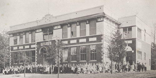 Model School with students standing around, 1918. Photo available from ECU Archives,  from TSQ, volume 5, page 246.