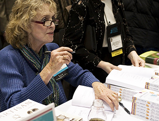 Author Lee Smith signing books in Boston, Mass. January 16, 2010. Image from Flickr user americanlibraries.