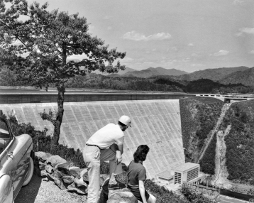 A view of the Fontana Dam and powerhouse, 1950s. North Carolina Collection, University of North Carolina at Chapel Hill Library.