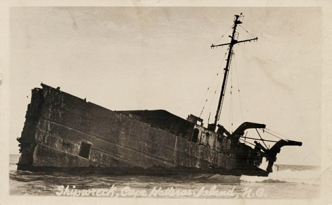 'Shipwreck, Cape Hatteras Island, N.C.' postcard of an unidentified shipwreck, circa 1929. Image from the Durwood Barbour Collection of North Carolina Postcards, North Carolina Collection of the University of North Carolina at Chapel Hill.