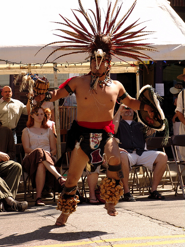 Aztec Dancer as Lexington Avenue Arts Fun Festival. Asheville, NC. Image courtesy of Flickr user Zen Sutherland.