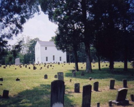 """Old St. Pauls Lutheran Church."" Organized before 1771 as a union church by German settlers. Present building erected ca. 1820. NC Highway Historical Marker O-63. Courtesy of North Carolina Office of Archives & History."