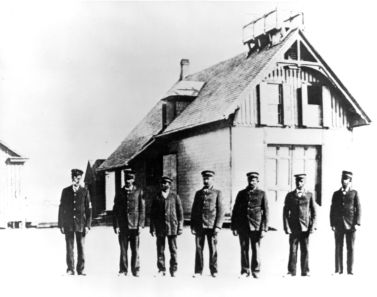 """Richard Etheridge, far left, and the Pea Island Life-Saving crew in front of their station, circa 1890. U.S. Coast Guard photo."" Image courtesy of the official U.S. Coast Guard Blog, 2010."